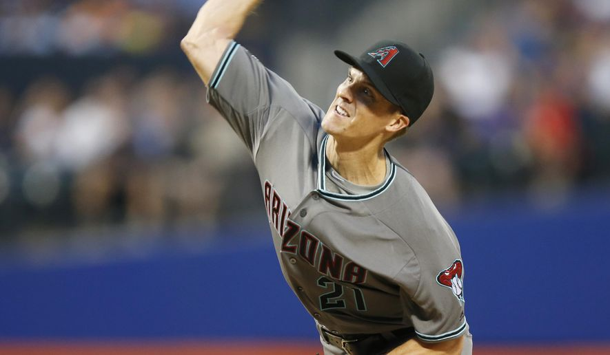 Arizona Diamondbacks starting pitcher Zack Greinke throws during the second inning of a baseball game against the New York Mets, Tuesday, Aug. 9, 2016, in New York. (AP Photo/Kathy Willens)