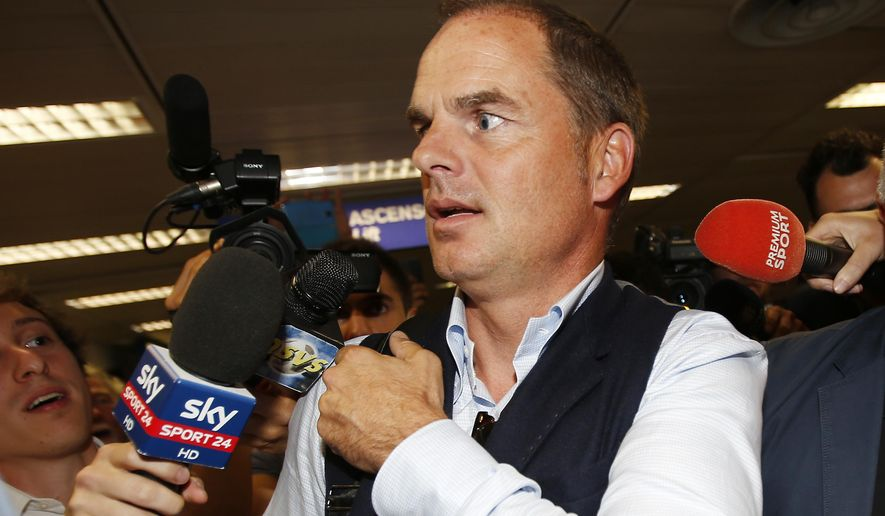Dutch football manager Frank de Boer arrives at the Milan's Linate airport, Italy, Monday, Aug. 8, 2016. De Boer is to meet Inter Milan officials as he is expected to replace  Roberto Mancini, who officially resigned today, as the new coach of the Milanese team. (AP Photo/Antonio Calanni)