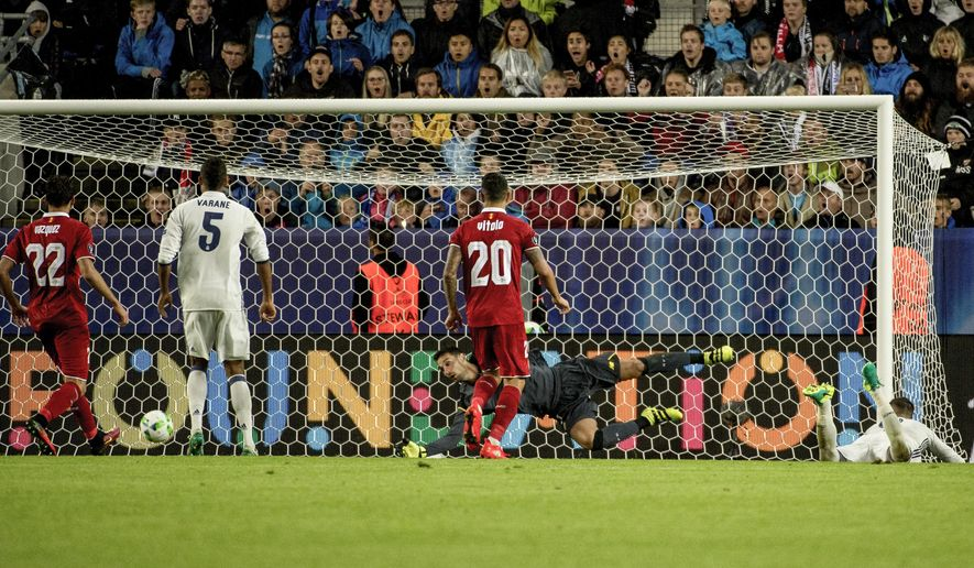 Real Madrid's Sergio Ramos, right, scores a goal, which was cancelled, against Sevilla during the Super Cup 2016 soccer match in Trondheim, Norway, Tuesday Aug. 9, 2016. (Ned Alley / NTB scanpix via AP)