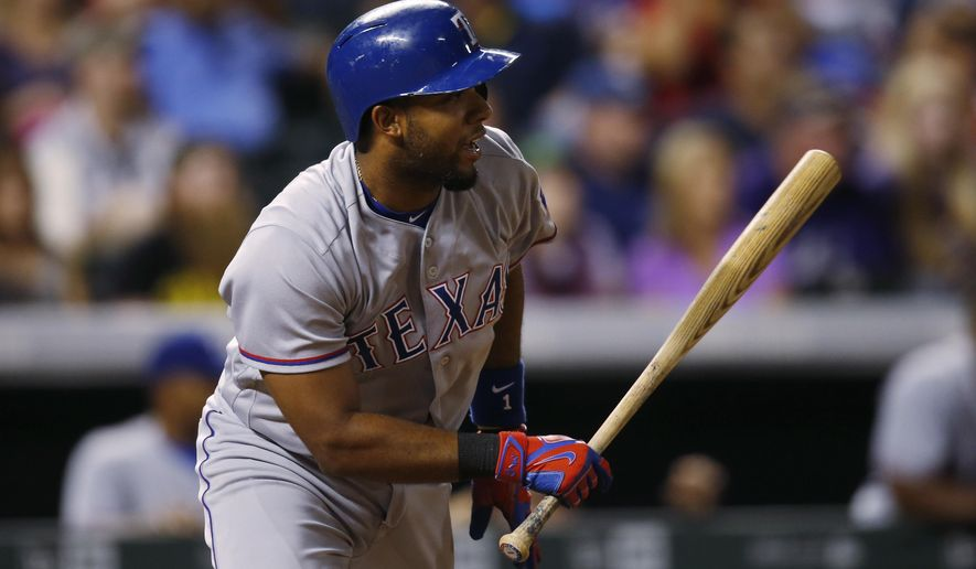 Texas Rangers' Elvis Andrus follows the flight of his single to drive in two runs off Colorado Rockies relief pitcher Carlos Estevez in the ninth inning of a baseball game, Monday, Aug. 8, 2016 in Denver. Texas won 4-3. (AP Photo/David Zalubowski)