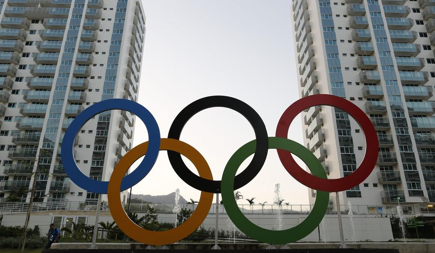 FILE - In this July 23, 2016 file photo, a representation of the Olympic rings are displayed in the Olympic Village in Rio de Janeiro, Brazil. Athletes increasingly are using apps like Tinder as they look to have fun and escape the pressures of competition inside the Olympic Village. (AP Photo/Leo Correa, File)