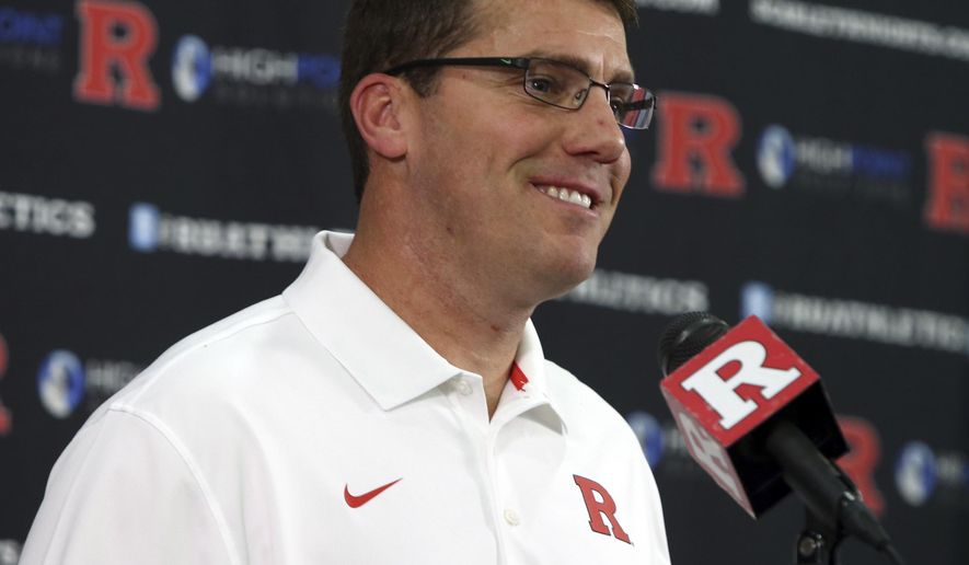 FILe - In this Jan. 12, 2016, file photo, Rutgers football coach Chris Ash speaks to reporters in Piscataway, N.J. Ash has given Rutgers a face lift in his first seven months as the coach.The former Ohio State co-defensive coordinator has changed just about everything predecessor Kyle Flood did in a tenure that ended with a 4-8 season, a training camp engulfed in player arrests and the coach at the center of an academic scandal. (Mark R. Sullivan/Asbury Park Press via AP, File)