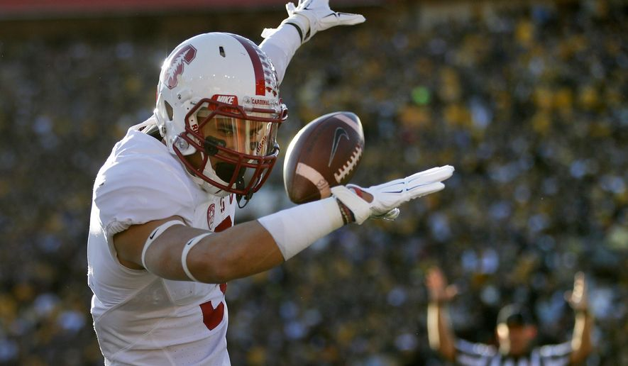 """FILE - In this Jan. 1, 2016 file photo, Stanford wide receiver Michael Rector celebrates after scoring against Iowa during the first half of the Rose Bowl NCAA college football game, in Pasadena, Calif. Stanford opened fall practice Monday, Aug. 8, 2016, with hopes of doing more than winning a fourth conference title in the past five seasons. """"We're kind of tired of just winning the Pac-12,"""" Rector said. """"We want to do bigger and better things. Always the goal is to win the Pac-12, but hopefully we can go to the national championship. That's what we're working for."""" (AP Photo/Jae C. Hong, File)"""
