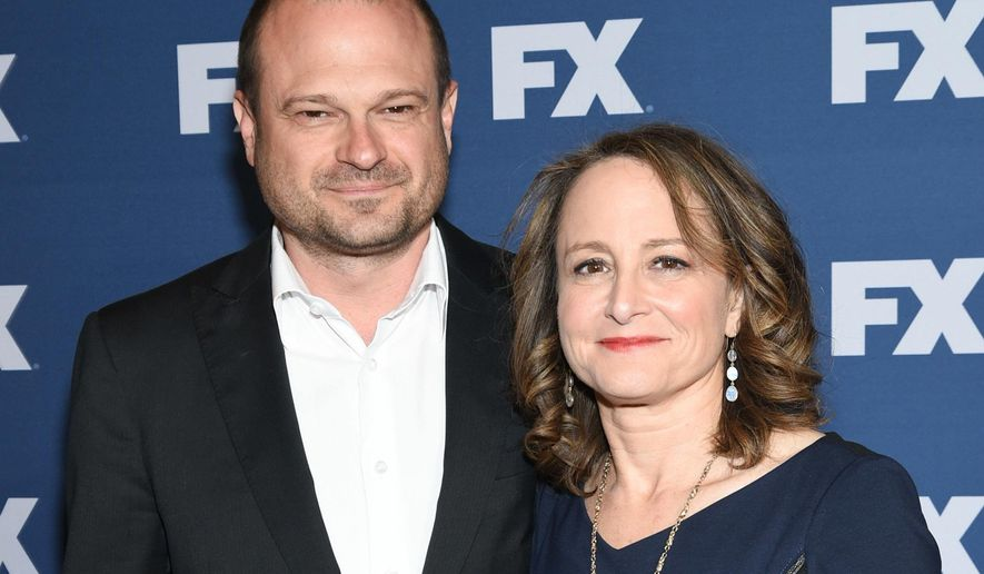 "FILE - In this March 30, 2016 file photo, executive producers Brad Simpson, left, and Nina Jacobson attend FX Networks upfront premiere of ""The People v. O.J. Simpson: American Crime Story"" in New York.  The writing team behind season two is hard at work on scripts for the next installment of the FX anthology series, which focuses on Hurricane Katrina.(Photo by Evan Agostini/Invision/AP, File)"