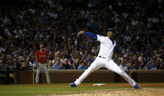 Chicago Cubs closer Aroldis Chapman throws against the Los Angeles Angels during the ninth inning of an interleague baseball game in Chicago, Wednesday, Aug. 10, 2016. The Cubs won 3-1. (AP Photo/Nam Y. Huh)