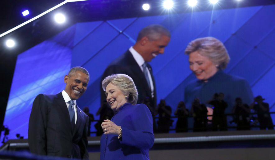 President Obama is joined by Democratic presidential candidate Hillary Clinton after speaking to the delegates during the third day session of the Democratic National Convention in Philadelphia on July 27, 2016. (Associated Press) **FILE**