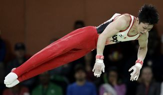 Japan's Kohei Uchimura performs on the horizontal bar during the artistic gymnastics men's individual all-around final at the 2016 Summer Olympics in Rio de Janeiro, Brazil, Wednesday, Aug. 10, 2016. (AP Photo/Dmitri Lovetsky)