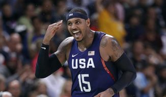 United States' Carmelo Anthony (15) celebrates after making a three-point basket during a basketball game against Australia at the 2016 Summer Olympics in Rio de Janeiro, Brazil, Wednesday, Aug. 10, 2016. (AP Photo/Charlie Neibergall)