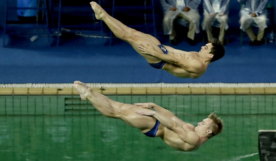 Britain's Jack Laugher and Chris Mears compete during the men's synchronized 3-meter springboard diving final in the Maria Lenk Aquatic Center at the 2016 Summer Olympics in Rio de Janeiro, Brazil, Wednesday, Aug. 10, 2016. (AP Photo/Matt Dunham)