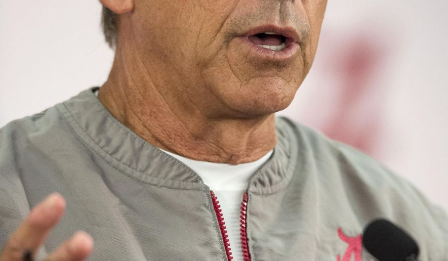 Alabama football coach Nick Saban talks to reporters Wednesday, Aug. 10, 2016, in Tuscaloosa, Ala. (Vasha Hunt/AL.com via AP)