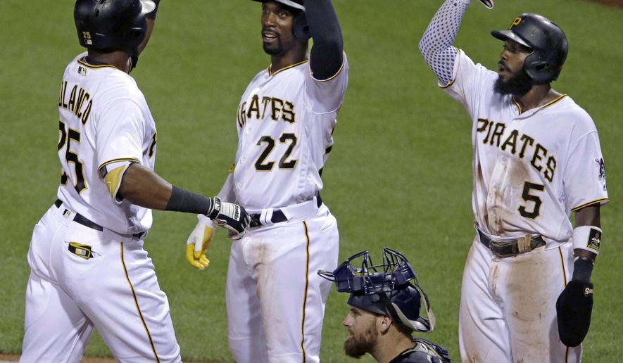 Pittsburgh Pirates' Gregory Polanco, left, is greeted by teammates Andrew McCutchen (22), and Josh Harrison (5) after hitting a three-run home run off San Diego Padres starting pitcher Luis Perdomo in the fifth inning of a baseball game in Pittsburgh, Tuesday, Aug. 9, 2016. The Pirates won, 6-4. (AP Photo/Gene J. Puskar)
