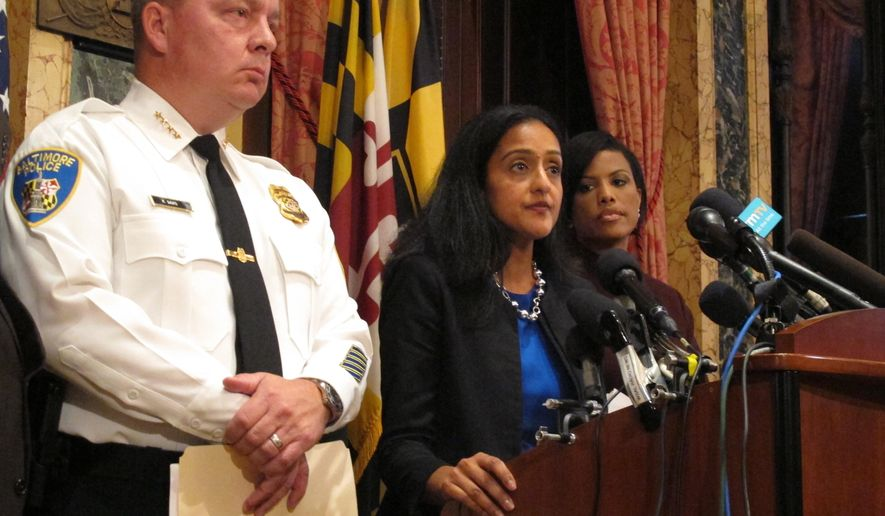 Vanita Gupta, head of the Justice Department's Civil Rights Division, discusses the department's findings on the investigation into the Baltimore City Police Department as  Police Commissioner Kevin Davis, left, and Mayor Stephanie Rawlings-Blake, right, listens on Wednesday, Aug. 10, 2016 at City Hall in Baltimore.  The Justice Department and Baltimore police agreed to negotiate court-enforceable reforms after a scathing federal report released Wednesday criticized officers for using excessive force and routinely discriminating against blacks.  (AP Photo/Brian Witte)