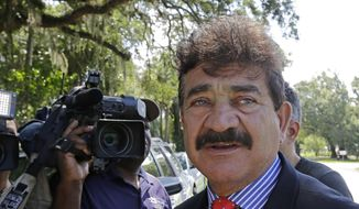 In this June 15, 2016, file photo, Seddique Mir Mateen, father of Omar Mateen, who died in a gun battle with a SWAT team after he opened fire at the gay nightclub Pulse early Sunday, talks to reporters, across the street of a residence owned by the family, in Fort Pierce, Fla. (AP Photo/Alan Diaz, File)