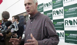 FILE - In this May 13, 2016, file photo, U.S. Sen. Ron Johnson, R-Wis., speaks with reporters in Green Bay, Wis., ahead of the Wisconsin Republican Party convention. Now with Wisconsin's largely perfunctory primary over, the table is set for the hotly contested Senate race between Johnson and Democrat Russ Feingold. (AP Photo/Scott Bauer, File)