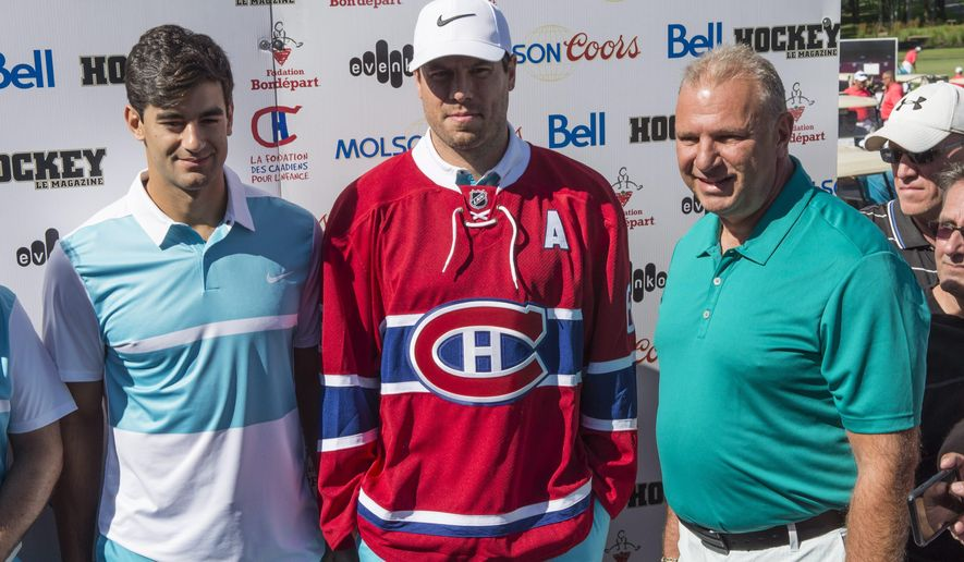 Montreal Canadiens head coach Michel Therrien, right, stands next to newly-acquired defenceman Shea Weber, center, and captain Max Pacioretty, at the Michel Therrien Golf Invitational Tuesday, Aug, 9, 2016 in Terrebonne, Quebec. Weber was acquired from the Nashville Predators in exchange for P.K. Subban. (Paul Chiasson/The Canadian Press via AP)