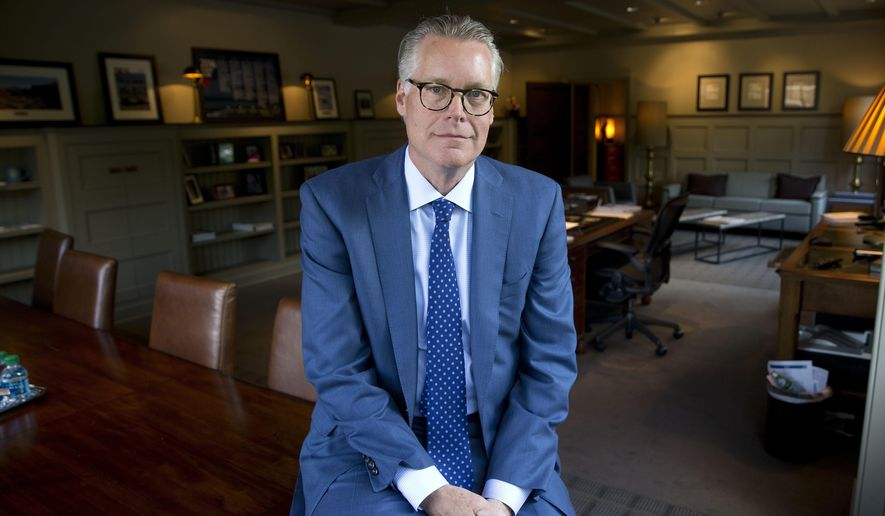 In this May 12, 2016, photo, Delta Air Lines CEO Ed Bastian poses for a portrait in his office at the company's headquarters in Atlanta.   (AP Photo/John Bazemore)
