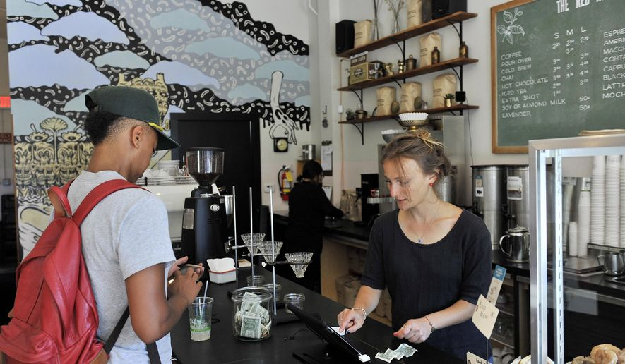 Julia Callis, right, waits on Stephanie Blair, at The Red Hook, a coffee shop on Agnes Street in West Village in Detroit on Tuesday, Aug. 9, 2016. Detroit has started an effort to improve the city's neighborhood main streets and ease bureaucratic hurdles that often stand in the way.  (Robin Buckson / The Detroit News via AP)