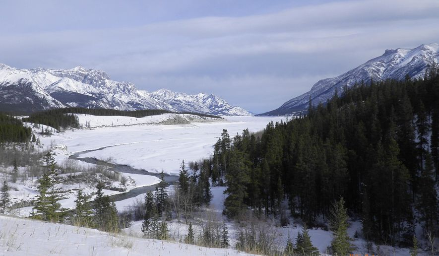 This February 2012 provided by researcher Mikkel Winther Pedersen shows a southward view down Cline River in Alberta, Canada, where retreating ice sheets created an ice-free corridor more than 13,000 years ago. This is part of the ice-free corridor which was ruled out for migration by the first people to colonize the Americas, since no evidence of plants or animals were found along this route until about 12,600 years ago. Studies suggest that people had reached South America by at least 14,700 years ago. So in recent years, many scientists have concluded that the first southward migrants traveled along the Pacific coast instead, either in boats or on land. (Mikkel Winther Pedersen via AP)