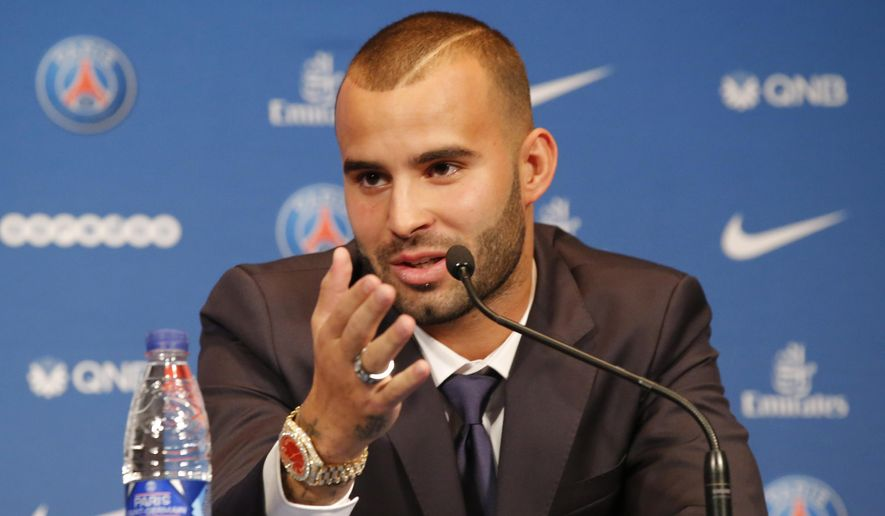 Spanish soccer player Jese Rodrigez, gestures as he speaks during a press conference at Parc des Princes stadium in Paris, Monday, Aug. 8, 2016. French champion Paris Saint-Germain bolstered its attack by recruiting Spanish forward Jese on a five-year deal from Real Madrid. (AP Photo/Michel Euler)