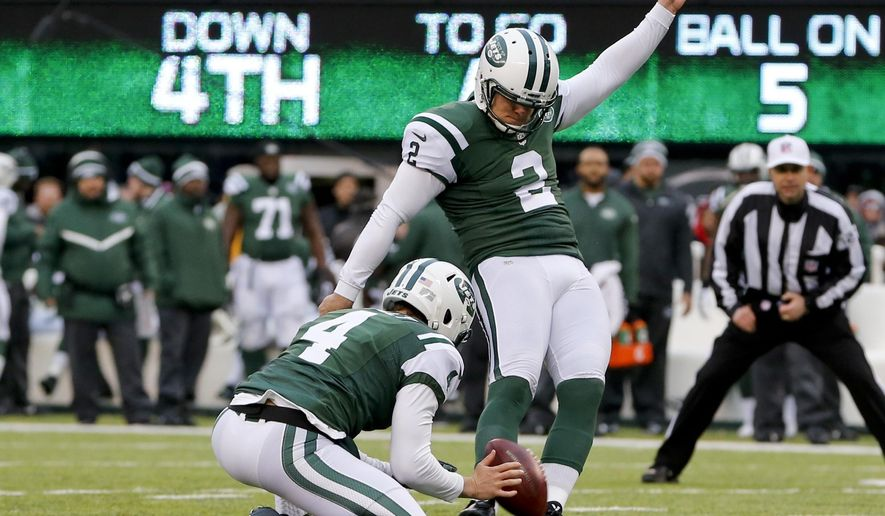 FILE - In this Dec. 21, 2014, file photo, New York Jets kicker Nick Folk (2) kicks a field goal during the second half of an NFL football game against the New England Patriots in East Rutherford, N.J. The jets  kicker is facing a tough challenge for his job from undrafted rookie Ross Martin, who has been just as good as Folk so far in training camp.(AP Photo/Julio Cortez)