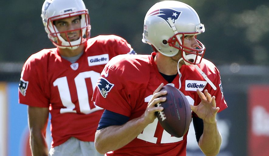 FILE - In this Tuesday, Aug. 9, 2016, file photo, New England Patriots quarterback Tom Brady (12) gets set to throw a pass as quarterback Jimmy Garoppolo (10) watches during NFL football training camp in Foxborough, Mass. This is one unusual summer for the Patriots, who have a quarterback quandary. How much should their four-time Super Bowl winner, Tom Brady, be on the field in preseason before he sits out the opening four games of the schedule while suspended? And how much action should his stand-in, Jimmy Garoppolo, get to prepare him to start those four matches that count? (AP Photo/Elise Amendola, File)
