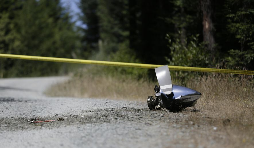 FILE - In this July 29, 2016, file photo, an engine nose cone with a bent propellor blade from a medical transport plane that crashed is shown on a road east of Crannell, Calif. A preliminary report from the National Transportation and Safety Board says the small medical plane broke up in flight last month and then crashed into a densely forested Northern California mountain range, killing all four people aboard.(Shaun Walker/The Times-Standard via AP, file)