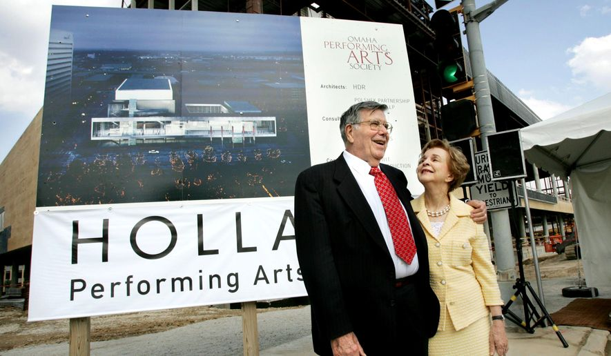 This photo taken Sept. 22, 2004, shows Richard Holland with his wife Mary. Richard Holland passed away Tuesday, Aug. 9, 2016, in Omaha, Neb. Holland, was a philanthropist whose last name graces Omaha's renowned performing arts center. His personal assistant, Debra Love, said Wednesday that Holland died at home Tuesday night. He was 95. Services are pending. (Phil Johnson/The World-Herald via AP)