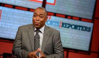 "In this May 12, 2013 photo provided by ESPN Images.  John Saunders poses on the set of ""The Sports Reporters"" in Studio A in Bristol, Conn. Saunders, who has hosted ""The Sports Reporters"" for the last 15 years, has died, the ESPN announced Wednesday, Aug. 10, 2016. He was 61. (Joe Faraoni/ESPN Images via AP)"