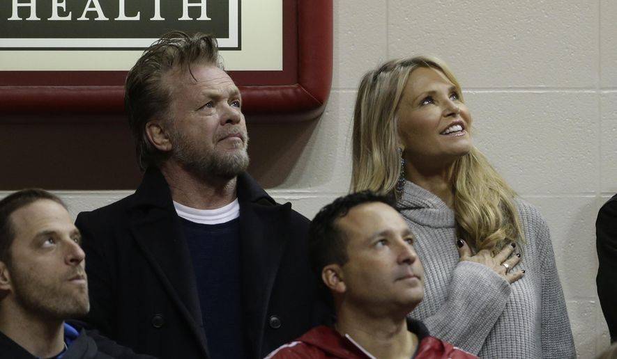 FILE - In this Jan. 23, 2016, file photo, John Mellencamp and Christie Brinkley attend an NCAA college basketball game between Indiana and Northwestern in Bloomington, Ind. A spokeswoman for both stars told The Associated Press on August 10, 2016, that they have ended their relationship after dating for about a year. (AP Photo/Darron Cummings, File)