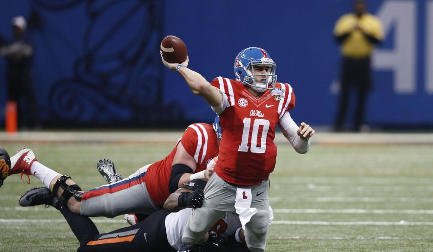 FILE- In this Jan. 1, 2016, file photo, Mississippi quarterback Chad Kelly (10) is tackled as he passes in the second half of the Sugar Bowl college football game against Oklahoma State in New Orleans. The pool of candidates for the Heisman Trophy is deep. Stanford's Christian McCaffrey and Clemson's Deshaun Watson are among the obvious ones, and Kelly could enter the race if things break right for him. (AP Photo/Bill Feig, File)