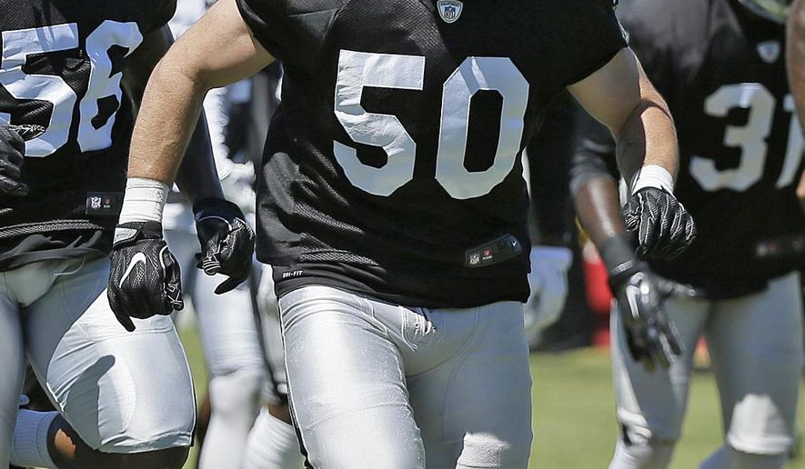 FILE - In this July 29, 2016, file photo, Oakland Raiders linebacker Ben Heeney (50) runs through obstacles during practice at the NFL football team's training camp in Napa, Calif. Heeney had been groomed to be Oakland's middle linebacker after being drafted in the fifth round out of Kansas in 2015. He had played more on the outside in college but the Raiders liked him in the middle, where he backed up veteran Curtis Lofton for most of last season. (AP Photo/Eric Risberg, File)