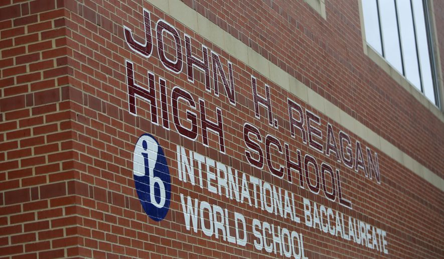 John H. Reagan Senior High School will be renamed to Heights High in Houston, Texas. The biggest school district in Texas will consider paying more than $1.2 million as part of changes to rename eight campuses previously named for Confederate leaders. The Houston Chronicle reports the Houston Independent School District board is expected to vote Thursday, Aug. 11, 2016, on a request by the interim superintendent, Ken Huewitt, to approve the cost. (Gary Coronado/Houston Chronicle via AP)
