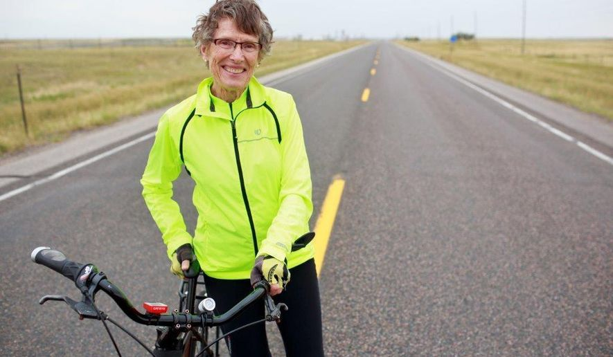 Lin Bruce, Cheyenne High School Class of 1956, rode her bicycle 660 miles from Northfield, Minn., to Cheyenne, Wyo., for the 60th class reunion recently. Bruce, 77, has ridden at least 18,000 miles on her bike since she was 60 years old. (Hugh Carey/The Wyoming Tribune Eagle via AP)