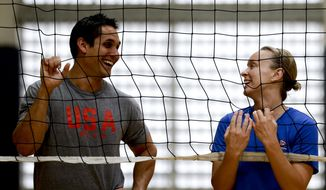 United States volleyball player Kayla Banwarth, right, and assistant coach David Hunt pose for a picture, Tuesday, May 24, 2016 in Anaheim, Calif. As the U.S. women chase their first Olympic gold medal in program history, Banwarth believes she's all the better as a player for having worked with the Pepperdine Waves. (AP Photo/Chris Carlson)
