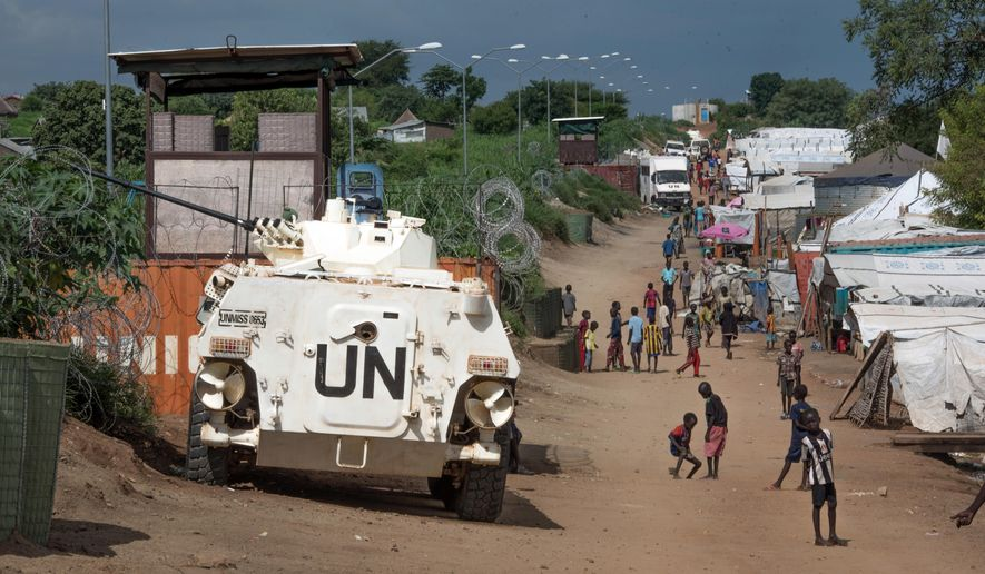 "FILE---In this file photo taken Monday, July 25, 2016, A UN armoured personnel vehicle stand in a refugee camp in Juba South Sudan. South Sudan on Wednesday, Aug. 10, 2016, rejected a U.S. proposal for the U.N. Security Council to send 4,000 additional troops to the East African country to restore calm, saying it ""seriously undermines"" its sovereignty and threatens a return to colonialism.  (AP Photo/Jason Patinkin/File)"