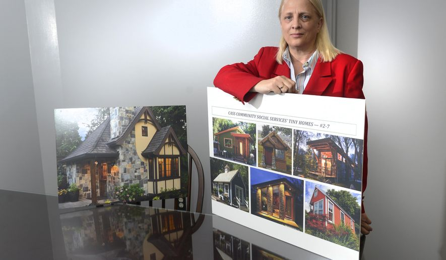 In a May 26, 2016 photo, Rev. Faith Fowler , executive director of Cass Community Social Services, shows tiny houses that will be built for low income residents in Detroit. Residents at first will rent homes and later may buy them. (Max Ortiz/The Detroit News via AP)