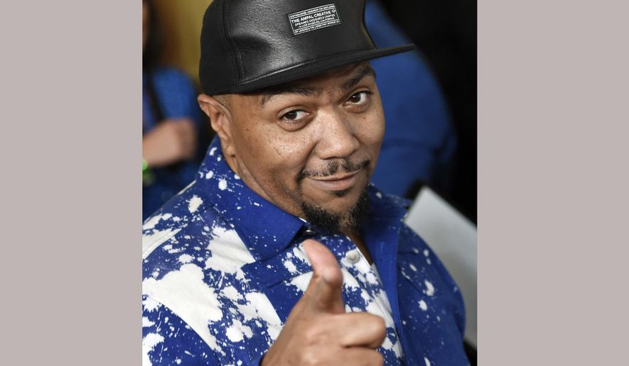 FILE - In this June 25, 2015 file photo, Timbaland arrives at the 2015 ASCAP Rhythm & Soul Awards in Beverly Hills, Calif.  The hitmaking producer is crafting songs for STRONG by Zumba, a new non-dance inspired workout focusing on high-intensity interval training, bodyweight exercises and strength training paired with music to match every move.(Photo by Chris Pizzello/Invision/AP, File)