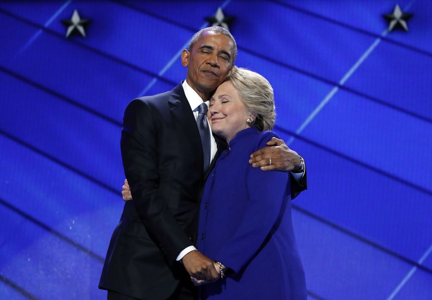President Barack Obama hugs Democratic Presidential candidate Hillary Clinton after addressing the delegates during the third day session of the Democratic National Convention in Philadelphia, Wednesday, July 27, 2016. (AP Photo/Carolyn Kaster) **FILE**
