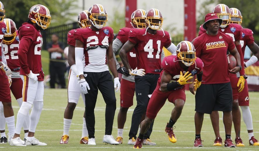 Washington Redskins cornerback Bashaud Breeland, front left, runs  drill during the afternoon practice at the Washington Redskins NFL football teams training camp in Richmond, Va., Friday, Aug. 5, 2016. (AP Photo/Steve Helber)