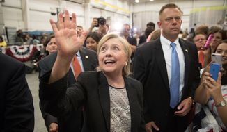 Democratic presidential candidate Hillary Clinton greets members of the audience after giving a speech on the economy after touring Futuramic Tool & Engineering, in Warren, Mich., Thursday, Aug. 11, 2016. (AP Photo/Andrew Harnik) ** FILE **