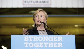 Democratic presidential candidate Hillary Clinton gives a speech on the economy after touring Futuramic Tool & Engineering, in Warren, Mich., Thursday, Aug. 11, 2016. (AP Photo/Andrew Harnik)