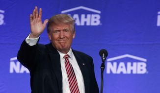 Republican presidential candidate Donald Trump waves after speaking to the National Association of Home Builders, Thursday, Aug. 11, 2016, in Miami Beach, Fla. (AP Photo/Evan Vucci)