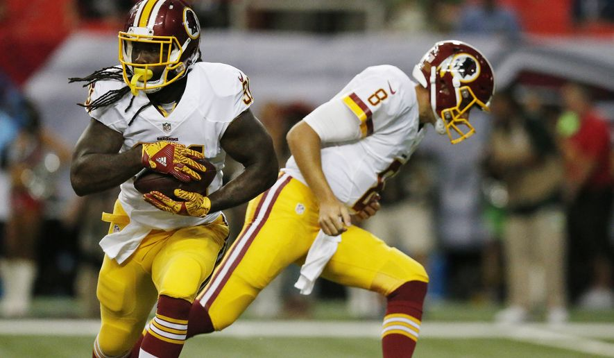 Washington Redskins running back Matt Jones (31) moves the ball against the Atlanta Falcons during the first half of a preseason NFL football game, Thursday, Aug. 11, 2016, in Atlanta. (AP Photo/Brynn Anderson)