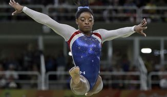 United States' Simone Biles performs on the balance beam during the artistic gymnastics women's individual all-around final at the 2016 Summer Olympics in Rio de Janeiro, Brazil, Thursday, Aug. 11, 2016. (AP Photo/Dmitri Lovetsky)