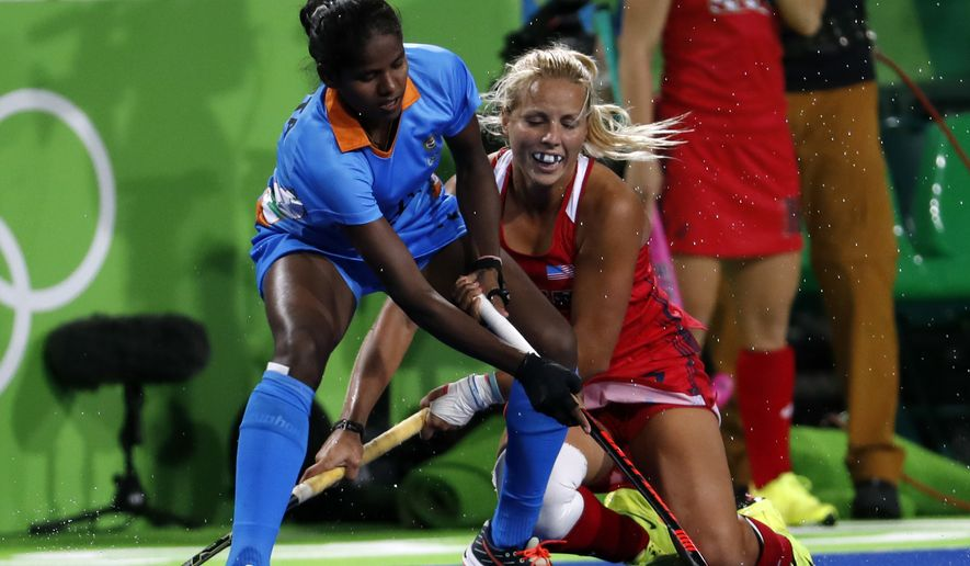 India's Namita Toppo, left, fights for the ball with United States' Kelsey Kolojejchick during a women's field hockey match at the 2016 Summer Olympics in Rio de Janeiro, Brazil, Thursday, Aug. 11, 2016. (AP Photo/Dario Lopez-Mills)