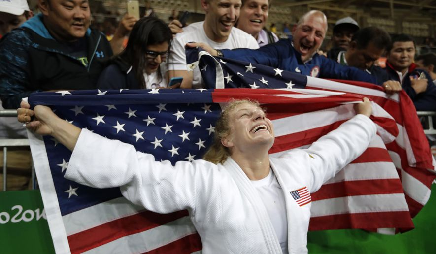 United States' Kayla Harrison celebrates her gold medal after defeating France's Audrey Tcheumeo in the women's 78-kg judo gold medal match at the 2016 Summer Olympics in Rio de Janeiro, Brazil, Thursday, Aug. 11, 2016. (AP Photo/Jae C. Hong)