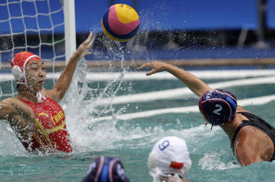 United States' Madeline Musselman, right, shoots and scores against China during women's water polo preliminary round match at the 2016 Summer Olympics in Rio de Janeiro, Brazil, Thursday, Aug. 11, 2016. (AP Photo/Sergei Grits)
