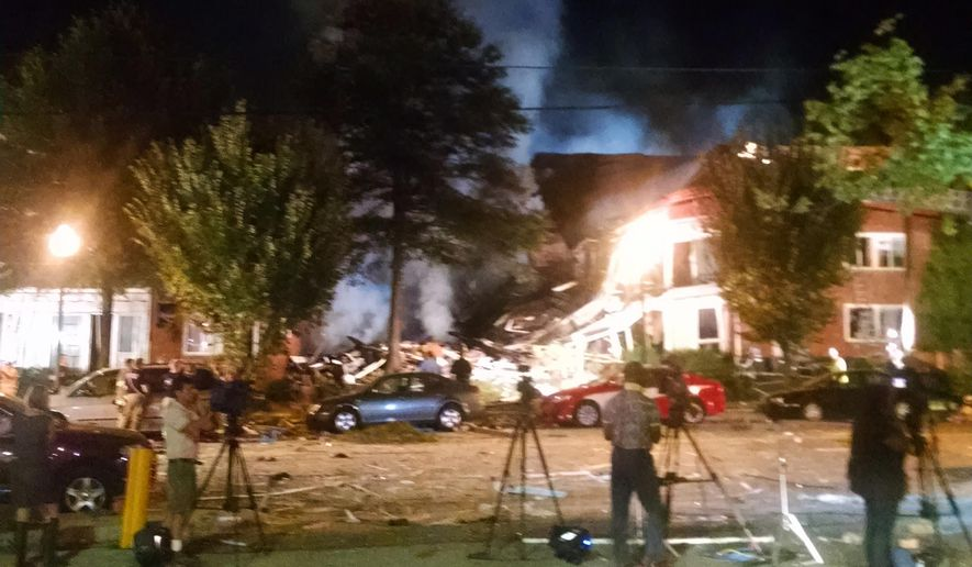 This Wednesday, Aug. 10, 2016, shows the Piney Branch Road apartment fire with structural collapse in Silver Spring, Md. Fire officials say at least 20 to 25 people, including two firefighters, have been injured in a large fire at an apartment building in a Maryland suburb of Washington. According to the Montgomery County Fire and Rescue Service, first responders were dispatched to the scene in Silver Spring just before midnight Wednesday. (Montgomery County Fire and Rescue via AP)