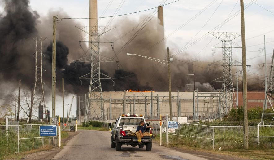 An emergency responder gets transported to the scene of a fire at the DTE Energy St. Clair Power Plant in East China Township, Mich., Thursday, Aug. 11. (Andrew Jowett/The Times Herald via AP)