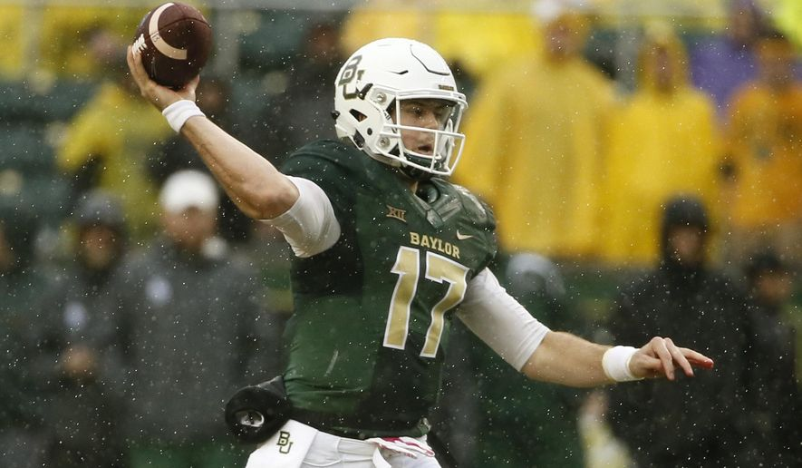 FILE - In this Oct. 24, 2015, file photo, Baylor's Seth Russell throws a pass in the first half of an NCAA college football game against Iowa State in Waco, Texas. If Russell stays healthy and can repeat what he was doing before getting hurt, the Bears could be near the top of the Big 12 standings.  (AP Photo/Tony Gutierrez, File)